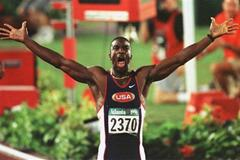 1 Aug 1996: Michael Johnson of the USA celebrates after his winning the men's 200 meters in a new world record time of 19.32 seconds in the Centennial Olympic Games at Olympic Stadium in Atlanta, Georgia. Johnson was the first man ever to win Olympic gol (Getty Images)