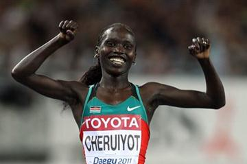 Vivian Jepkemoi Cheruiyot of Kenya celebrates as she crosses the finish line to win the women's 10,000 metres final during day one  (Getty Images)