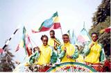 Ethiopian team are welcomed home on top of a bus in Addis Ababa (Abel Tadege)