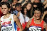 Elena Lashmanova of Russia races to a gold medal in front of Shenjie Qieyang of China who took bronze during the Women's 20km Walk final of the London 2012 Olympic Games on the streets of London on August 11, 2012  (Getty Images)