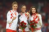 The 2008 Olympic High Jump podium - Tia Hellebaut (centre) with Blanka Vlasic (left) and Anna Chicherova (right) (Getty Images)